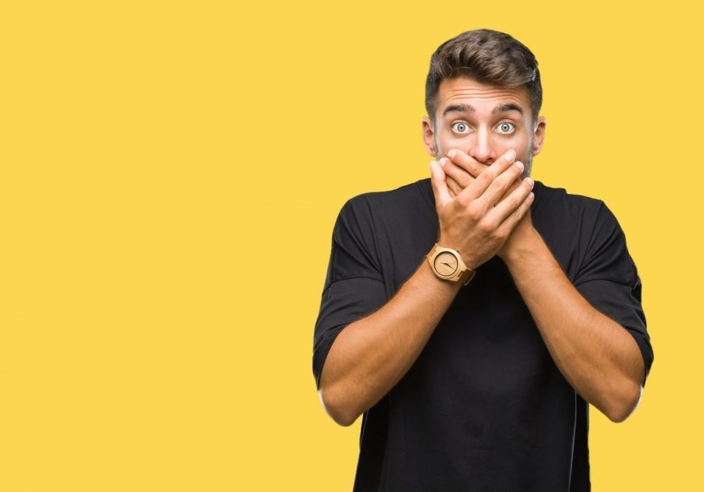 young man visibly shocked by the common branding mistakes companies make