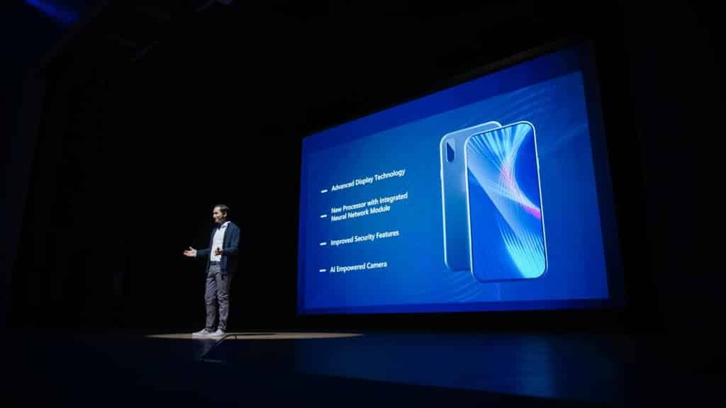 Presenter-On-Stage-Presenting-New-Tech-Gadget